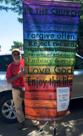 Phil with the Trinity UCC banner - be the church - up north pride parade, June 2016