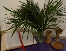 Bible, palms, chalice and paten on the Saturday afternoon before Palm Sunday, March 19, 2016