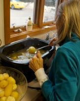 Patricia dishing up potatoes