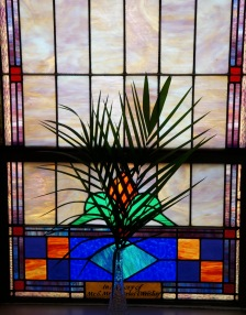 Wrisley stained glass window with a palm